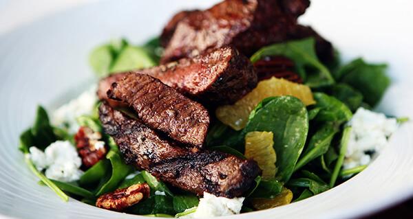 delicious steak salad in fine dining restaurant for senior living
