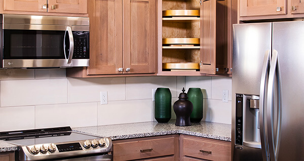senior living suite amenities include custom cabinetry and stainless steel appliances